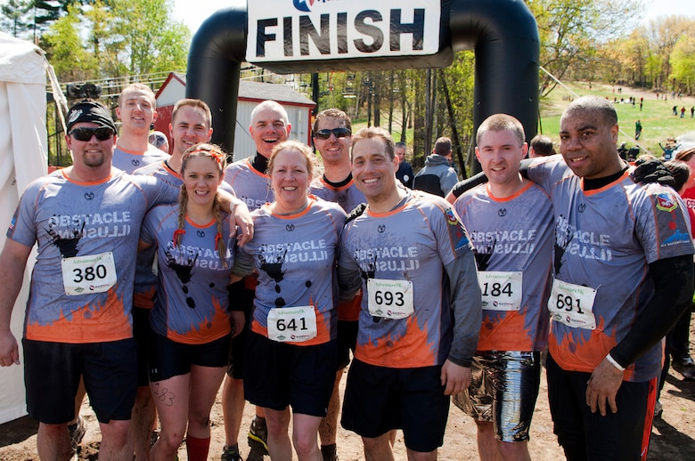 MANCHESTER, N.H. -- Obstacle Illusion, a team comprised of members of the New Hampshire Air National Guard pose after competing in the Adventure 5k at McIntyre Ski Area April 28. More than 800 participants ran through mud trails and over obstacles during the 3.1 mile event. (National Guard photo by Tech. Sgt. Mark Wyatt/Released)