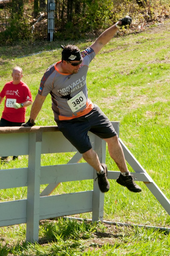 MANCHESTER, N.H. -- Tech. Sgt. Mike Keegan hurdles an obstacle at the Adventure 5k at McIntyre Ski area April 28. Keegan and ten others from the New Hampshire Air National Guard participated as a team called Obstacle Illusion. (National Guard photo by Tech. Sgt. Mark Wyatt/Released)