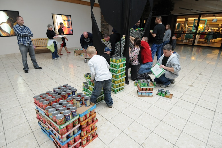 Servicemembers from the 110th Airlift Wing, Battle Creek Air National Guard Base and their families participate in the local food drive Canned Sculpture Exhibit held at Lakeview Square Mall, Battle Creek, Mich., on Sunday, April 22, 2012. A donation of over $600 was collected toward the sculpture equaling over a 1,000 cans. All food collected is donated to the Food Bank of South Central Michigan. Sculptures will be on display until Sunday, May 6, 2012. (U.S. Air National Guard Photo by Master Sgt. Sonia Pawloski/Released)