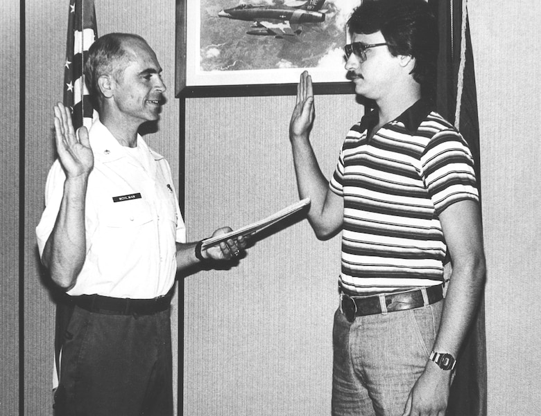 Master Sgt. Brian Mohlman makes his first oath of enlistment on June 4, 1979 at the Battle Creek Air National Guard Base, Mich. Master Sgt. Mohlman is sworn in by Lt. Col. Harold Mohlman (retired), his father. (U. S. Air National Guard Photos courtesy of 110th Force Support Squadron Master Sgt. Brian Mohlman/Released)