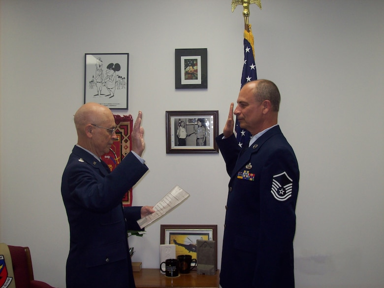 Master Sgt. Brian Mohlman makes his final oath of enlistment on Friday, April 13, 2012 at the Battle Creek Air National Guard Base, Mich. Master Sgt. Mohlman is sworn in by Lt. Col. Harold Mohlman (retired), his father. (U. S. Air National Guard Photos courtesy of 110th Force Support Squadron Master Sgt. Brian Mohlman/Released)