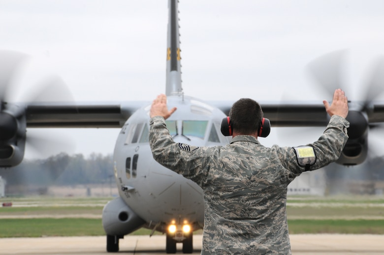 Master Sgt. David Moessinger, crew chief for the 110th Airlift Wing launches two C-27J Aircraft carrying Army soldiers from the 351st Aviation Support Battalion, on Saturday, March 31, 2012 at Battle Creek Air National Guard Base, Battle Creek, Mich. (U.S. Air National Guard photo by Master Sgt. Sonia Pawloski/released)