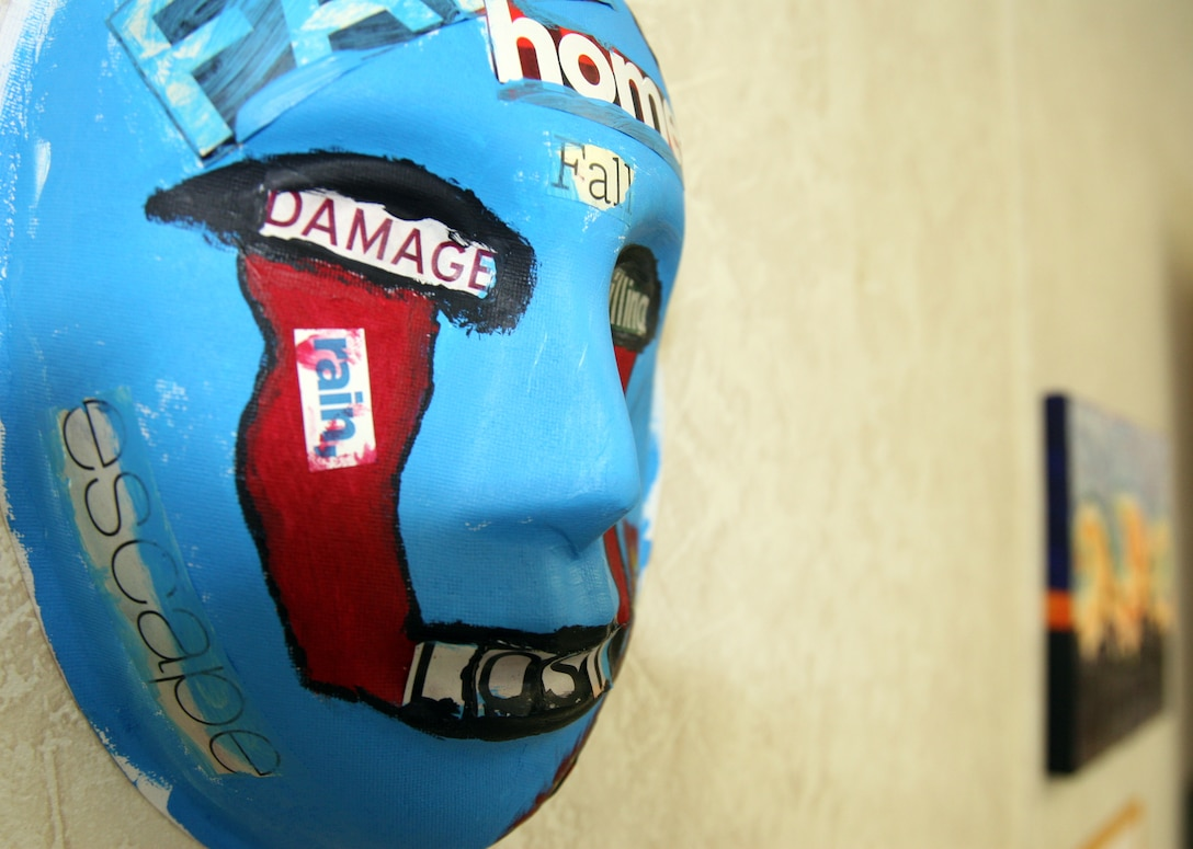 A mask, painted by a Marine who attends art therapy to relieve post-traumatic stress disorder symptoms, is displayed at an art expo May 3. The expo provided a way to raise awareness about PTSD and the benefits of art therapy. During therapy sessions, participants use a variety of art supplies, including paints, clay, markers, charcoal and images for collages, to express their thoughts, feelings and memories.  (Official U.S. Marine Corps photo by Cpl. Andrew Johnston)
