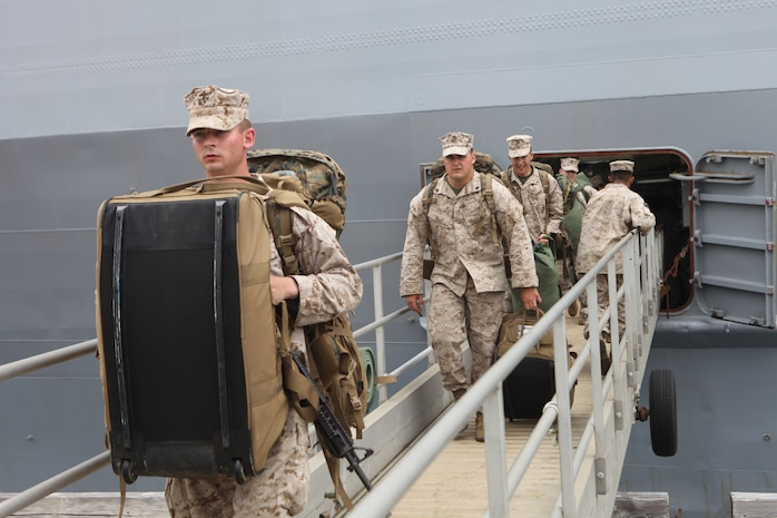 Marines with Company C., Battalion Landing Team 1st Battalion, 4th Marines, 31st Marine Expeditionary Unit, disembark the USS Denver (LPD-9) here following the month-long bilateral training Exercise Balikatan in the Philippines, May 3. Balikatan, (shoulder-to-shoulder in English) is the last training evolution 1/4 will take part in before detaching from the 31st MEU and returning to their home garrison on Marine Corps Base Camp Pendleton. The 31st MEU is the only continuously forward-deployed MEU and remains the nation's force in readiness in the Asia-Pacific region.