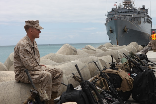 Cpl. John Wellford, machine gunner with Weapons Plt., Company C., Battalion Landing Team 1st Battalion, 4th Marines, 31st Marine::r::::n::Expeditionary Unit, guards weapons after disembarking from the USS Denver (LPD-9) here following the month-long bilateral training Exercise Balikatan in the Philippines, May 3. Balikatan,::r::::n::(shoulder-to-shoulder in English) is the last training evolution 1/4::r::::n::will take part in before detaching from the 31st MEU and returning to their home garrison on Marine Corps Base Camp Pendleton. The 31st MEU is the only continuously forward-deployed MEU and remains the nation's force in readiness in the Asia-Pacific region.
