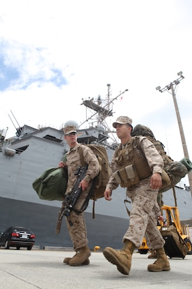 Sgt. Louis Vasquez (right), chief cook with Headquarters and Service Company, Battalion Landing Team 1st Battalion, 4th Marines, 31st Marine Expeditionary Unit, walks with Lance Cpl. Andrew Cunningham, team leader with Company C., BLT 1/4, after disembarking from the USS Denver (LPD-9) here following the month-long bilateral training Exercise Balikatan in the Philippines, May 3. Balikatan, (shoulder-to-shoulder in English) is the last training evolution 1/4 will take part in before detaching from the 31st MEU and returning to their home garrison on Marine Corps Base Camp Pendleton. The 31st MEU is the only continuously forward-deployed MEU and remains the nation's::r::::n::force in readiness in the Asia-Pacific region.