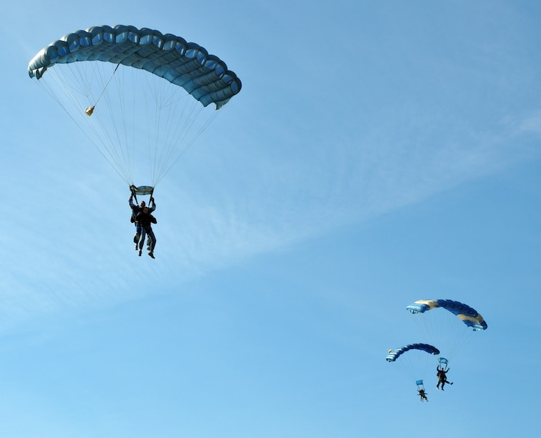 Members of Team Beale descend towards their landing zone during the Jump Into Prevention skydiving event at Lincoln Regional Airport, Calif., April 27, 2012. The Airmen made the tandem skydive with a local skydiving instructor to promote sexual assault awareness.