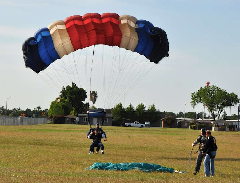 Col. Phil Stewart, 9th Reconnaissance Wing vice commander lands, at a drop zone during Team Beale's Jump Into Prevention skydiving event at  Lincoln Regional Airport, Calif., April 27, 2012. Stewart and more than 70 Airmen skydived to promote sexual assault awareness.