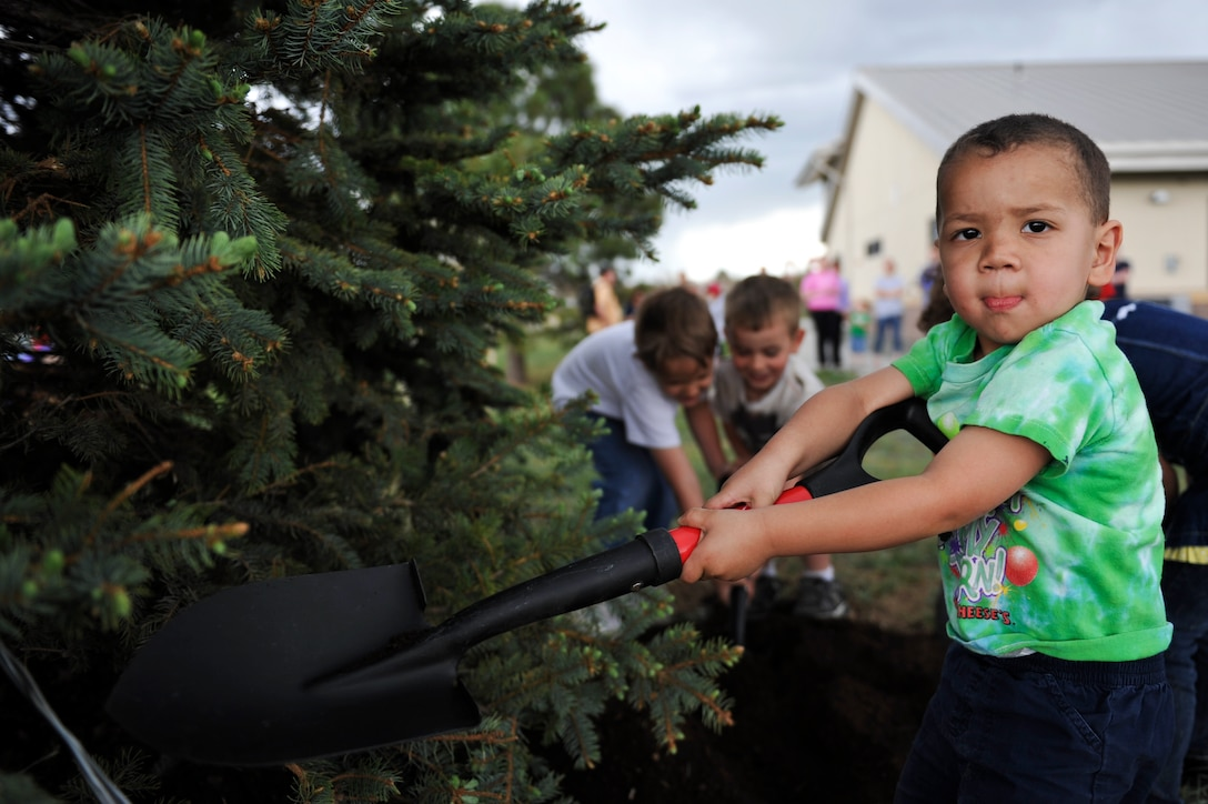 BUCKLEY AIR FORCE BASE, Colo. – Thomas Tegtman, from the Buckley Child Development Center, plants a tree for Buckley's Arbor Day Celebration, April 26, 2012. These children contributed to helping Buckley's environment and were taught the meaning of Arbor Day. (U.S. Air Force photo by Airman 1st Class Darryl Bolden Jr.)