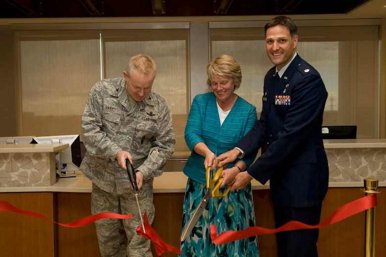 BUCKLEY AIR FORCE BASE, Colo. --   From left to right, Col. Daniel Dant, 460th Space Wing commander, Lynette A. Roff, Director of Veteran Affairs Eastern Colorado Health Care System, and Lt. Col. Scot Spann, 460th Medical Group deputy commander, cut the ribbon signifying the opening of the new Buckley Clinic, April 26, 2012.  The clinic was built as a collaboration between Buckley AFB and the VA, saving Buckley more than $150,000 a year. (U.S. Air Force photo by Airman 1st Class Phillip Houk)