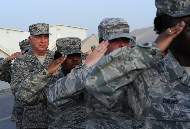 SOUTHWEST ASIA - Mitch Hebert takes part in the weekly retreat ceremony at the 380th Air Expeditionary Wing April 27, 2012. Hebert, the deputy commander of the 380th Expeditionary Force Support Squadron, is on the first deployment of his 31-year career as a civil servant. The Biloxi, Miss., native has held a variety of Air Force Services positions at bases all over the world, but deploying with Airmen to Southwest Asia has long been a career goal for him. (U.S. Air Force photo/Staff Sgt. J.G. Buzanowski)