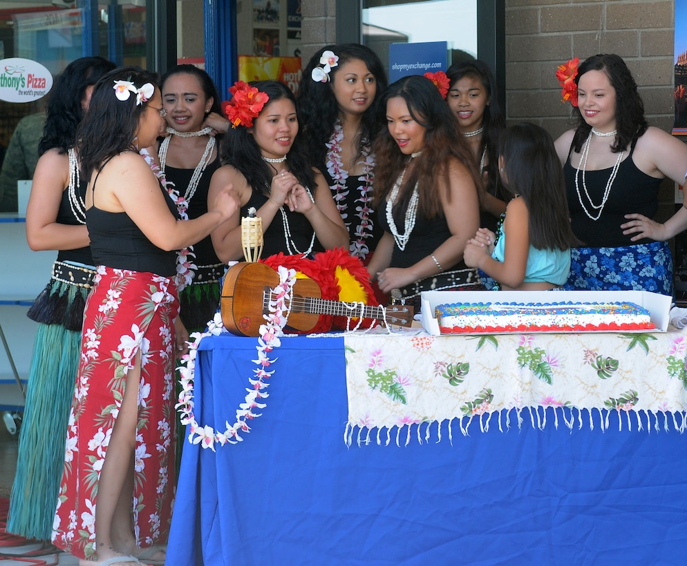 Members of Team Beale's Tiaré Polynesia dance group celebrate Beale's Asian American/ Pacific Islander Heritage Month at Beale Air Force Base, Calif., May 1, 2012. May was chosen to commemorate the immigration of the first Japanese to the United States on May 7, 1843, and to mark the anniversary of the completion of the transcontinental railroad on May 10, 1869. The majority of the workers who laid the tracks were Chinese immigrants. (U.S. Air Force photo by Senior Airmen Allen Pollard/Released)