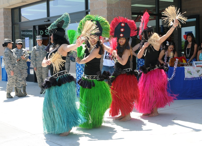 Members of Team Beale's Tiaré Polynesia group dance in front of the Base Exchange to kick off Beale's Asian American/ Pacific Islander Heritage Month at Beale Air Force Base, Calif., May 1, 2012. The month is celebrated with community festivals, government-sponsored activities, and educational activities for students. (U.S. Air Force photo by Senior Airmen Allen Pollard/Released)
