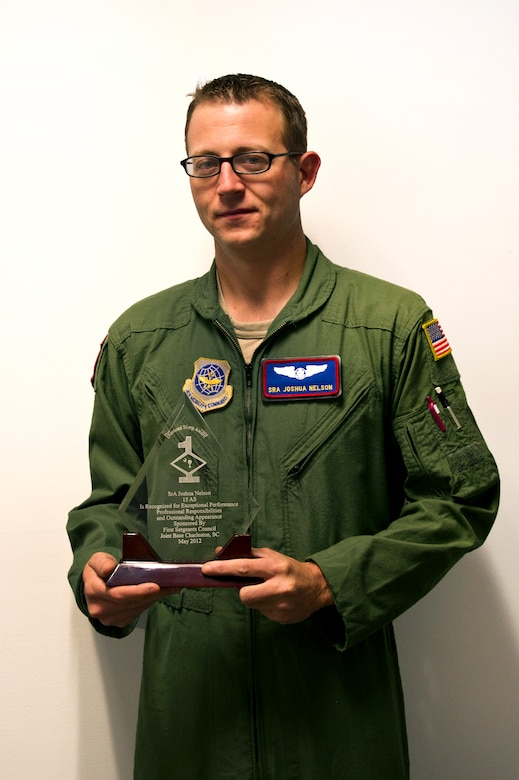 Senior Airman Joshua Nelson poses for a photo with his Diamond Sharp award at Joint Base Charleston May 2. The Diamond Sharp recipients were Airman 1st Class Jodi Martinez, 1st Combat Camera Squadron, Airman 1st Class Robert Ealey, 437th Aerial Port Squadron, 437th Airlift Wing, and Senior Airman Joshua Nelson, 15th Airlift Squadron, 437th AW. The Diamond Sharp awardees are Airmen chosen by their first sergeants for their excellent performance. (U.S. Air Force photo/Airman 1st Class George Goslin)