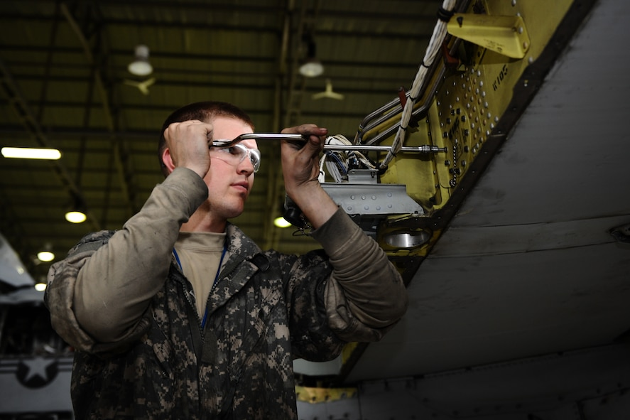 SPANGDAHLEM AIR BASE, Germany – Senior Airman Brian Baker, 52nd Equipment Maintenance Squadron A-10 Thunderbolt II phase technician, works to remove an aileron bracket on the wing of an A-10 during a phase inspection in Hangar 2 here May 4. The phase inspections are separated into two categories. During a phase 1 inspection, the 52nd EMS Maintenance Flight members examine each A-10 after every 500 flying hours, and phase 2 inspections are performed every 1,000 flying hours. These inspections allow the Airmen to check for deficiencies and perform preventative maintenance to ensure the aircraft is safe and operational for flight. (U.S. Air Force photo by Airman 1st Class Matthew B. Fredericks/Released)
