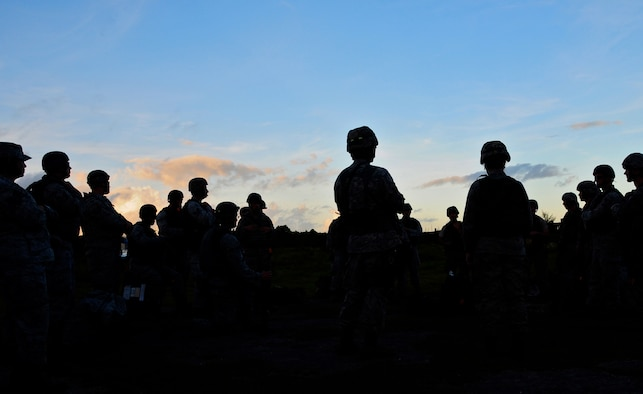ANDERSEN AIR FORCE BASE, Guam--Members of the 644th Combat Communications Squadron listen to a security brief upon arrival on forward operating base Dragon Hill April 18. FOB Dragon Hill is the location for Dragon Thunder, an exercise where the 644 CBCS train and test their capabilities in a bare-base environment. (U.S. Air Force photo by Airman 1st Class Marianique Santos)