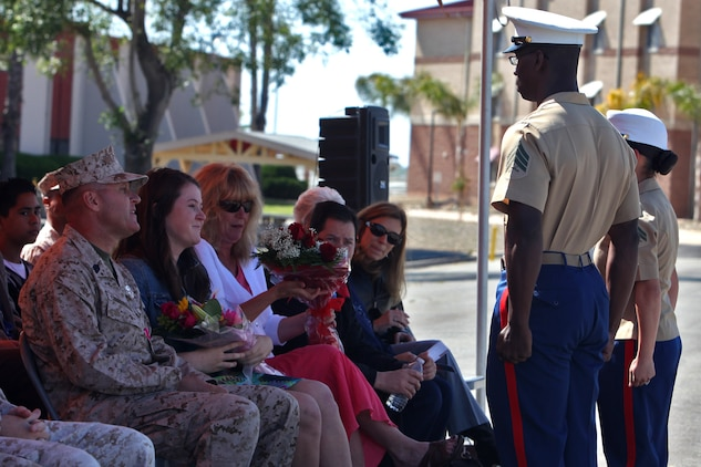 The family of Sgt. Maj. Richard D. Cunningham receives flowers from the 15th Marine Expeditionary Unit during Cunningham's retirement ceremony aboard Camp Pendleton, Calif., May 4. Cunningham retired after 29 years of faithful service to the Marine Corps. (U.S. Marine Corps photo by Lance Cpl. Timothy Childers)