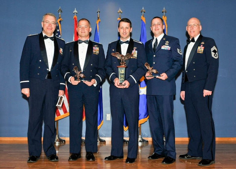From left to right: Maj. Gary Bentley, wing executive officer; Lt. Col. Tim Moses, operations support squadron commander; Col. Steve Nordhaus, wing commander; Tech. Sgt. Bruce Hedrick, command post controller and Chief Master Sgt. Scott Boyer, Aerospace Control Alert chief of enlisted maintenance.