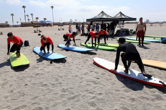 A Jimmy Miller Memorial Foundation volunteer instructor gives a tutorial of proper surfing technique to service members with the Wounded Warrior Battalion in Del Mar, May 5. The JMMF ocean therapy program facilitates improved self-esteem for service members dealing with mental and physical illness.