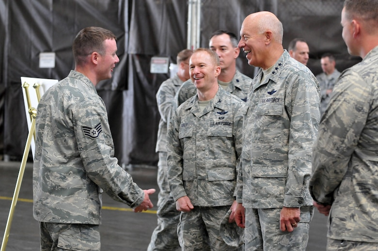 Lt. Gen. Harry (Bud) Wyatt and Col. Richard Kelley talk with Staff Sgt. Trevor Volack from the 141st AMXS. (U.S. Air Force Photo by Staff Sgt. Anthony Ennnamorato)