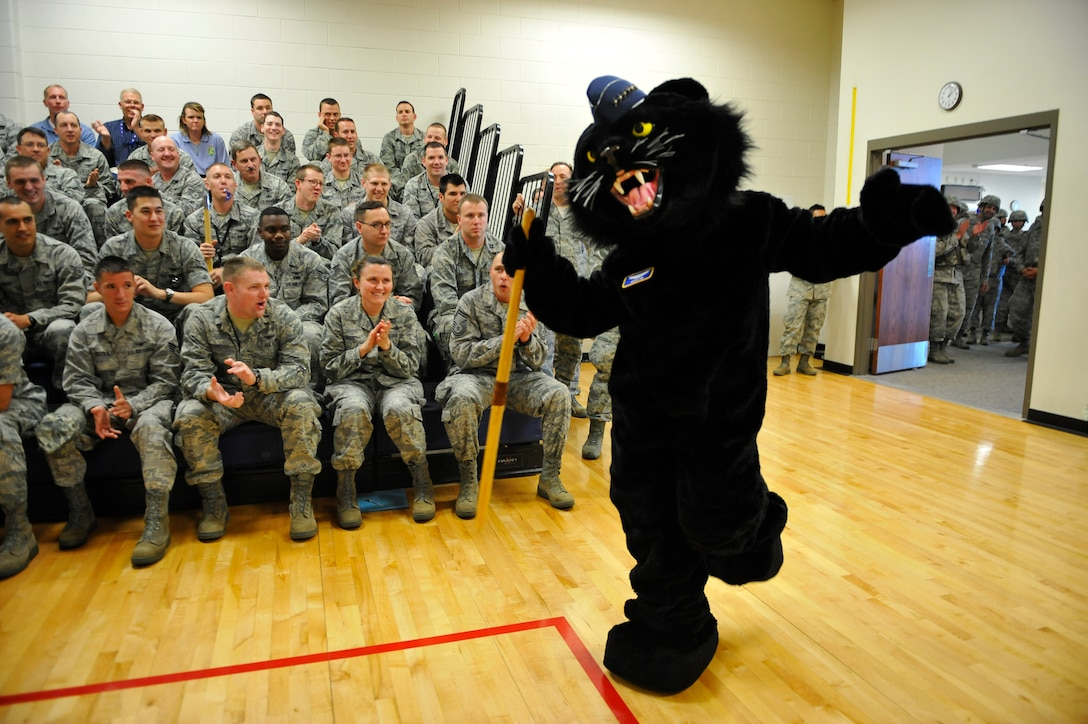 """BUCKLEY AIR FORCE BASE, Colo. – Panther """"General Buck Lee,"""" 460th Space Wing mascot, dances his way into the Buckley Fitness Center gym May 4, 2012, to kick off a commander's call. Hundreds of Airmen rallied into the gym to review expectations of the upcoming Operational Readiness Inspection, which is scheduled for May 11-22. (U.S. Air Force photo by Staff Sgt. Kathrine McDowell)"""