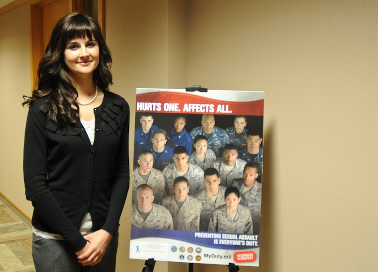 Ellsworth's new Sexual Assault Responder coordinator, Kelly Dominguez, stands by a sexual assault prevention poster at the Rushmore Center on Ellsworth Air Force Base, S.D., April 23, 2012. In support of April being sexual assault awareness month, the SARC office has displayed posters and set up tables throughout the base informing Airmen about sexual assault awareness and prevention. (U.S. Air Force photo by Airman 1st Class Anania Tekurio/Released)