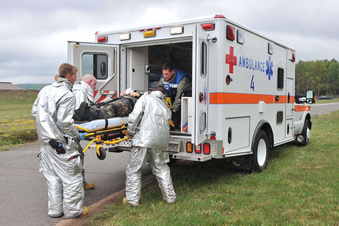 Members of the Ramstein Fire Department join with medical personnel while responding to an operational readiness exercise scenario on Ramstein Air Base, Germany, May 5, 2012. The ORE incorporates a series of scenarios used to evaluate Team Ramstein's ability to execute operational duties while responding to various crises. (U.S. Air Force photo/Senior Airman Caitlin O'Neil-McKeown)