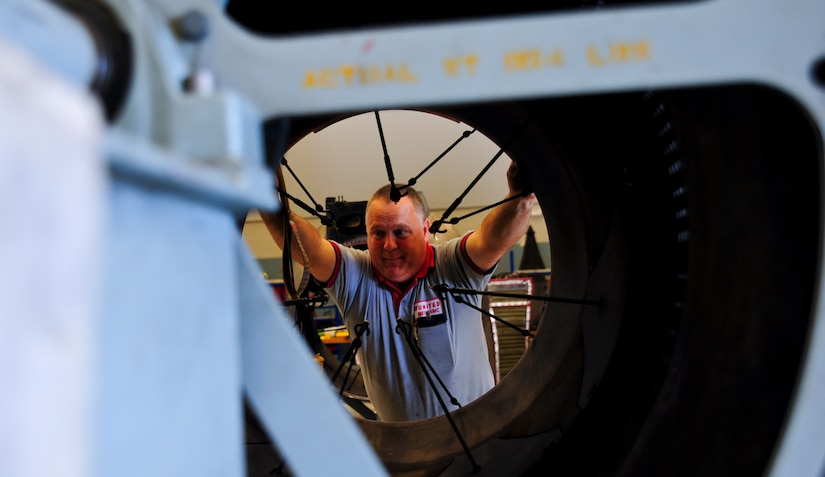 Danny Page assembles the core thrust reverser on an F-117 engine at Joint Base Charleston – Air Base May 3. Page served in the Air Force at Dover Air Force Base, Del., as a crew chief on a C-5 Galaxy. The F-117 engine is used on the C-17 Globemaster III. Page is a United Airlines aircraft maintenance technician. (U.S. Air Force photo/Airman 1st Class Dennis Sloan)
