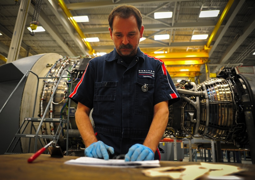 Jerry Zuk reviews an inspection checklist after removing several tags from an F-117 engine at Joint Base Charleston – Air Base May 3. Zuk, a retired Air Force crew chief, inspects the engine several times throughout the build-up process. Once the engine is inspected, tested and certified, it is installed on a C-17 Globemaster III. Zuk is a United Airlines F-117 engine inspector. (U.S. Air Force photo/Airman 1st Class Dennis Sloan)