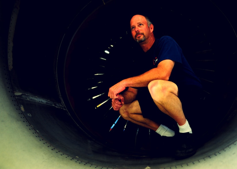 Tim Gorman stops for a photo in a C-17 Globemaster III engine inlet at the Joint Base Charleston – Air Base C-17 engine shop May 2. Goreman is an aviation maintenance technician with United Airlines. (U.S. Air Force photo/Staff Sergeant Katie Gieratz)