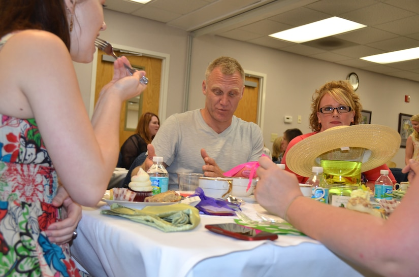 """Terry Serpico has tea with military spouses at the Joint Base Charleston - Air Base Airman and Family Readiness Center, May 5. Serpico is an actor on Lifetime Network's television series, """"Army Wives"""" and for the last five seasons has played the role of Army Lt. Col. Frank Sherwood. The spouses were being honored as part of Military Spouse Appreciation Day which included massages, hair styling salon, tea and other events. The sixth season of """"Army Wives"""" premiered May 1 on the Lifetime Network and the majority of the show is filmed in North Charleston, S.C. (U.S. Air Force Photo / Airman 1st Class Tom Brading)"""