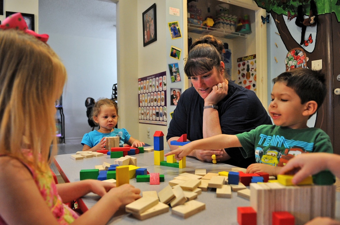 Jeanette Going watches as children play with wooden blocks on Seymour Johnson Air Force Base, N.C., May 7, 2012. Jeanette is one of a few accredited and U.S. Air Force trained home family child care providers in Wayne County, N.C. making her a valid source for military personnel and DoD civilians with child care needs. Jeanette is the spouse of Tech. Sgt. Wesley Going, 4th Equipment Maintenance Squadron aircraft ground equipment readiness NCO in charge, and hails from Bristol, Conn. (U.S. Air Force photo/Airman 1st Class Aubrey Robinson/Released)