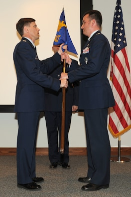 Lt. Col. Richard D. Henderson, right, the new commander of the 222nd Command and Control Squadron, receives the squadron guidon from Col. Greg Semmel, commander of the 174th Fighter Wing, during a ceremony Friday at the Rome Air Force Research Laboratory.