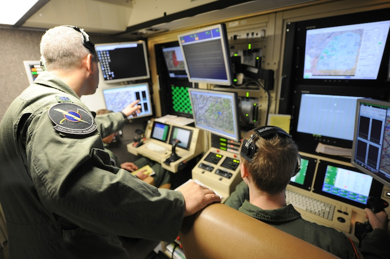 An instructor pilot makes a point during a MQ-9 Reaper training mission flown from a ground-based cockpit located at Hancock Field Air National Guard Base, Syracuse, New York.  The 174th Fighter Wing is the only Air National Guard unit in the country to operate a MQ-9 Formal Training Unit (FTU) program to train aircrews from the active duty Air Force, Air National Guard and Air Force Reserve.(photo by Tech. Sgt. Ricky Best/Released)