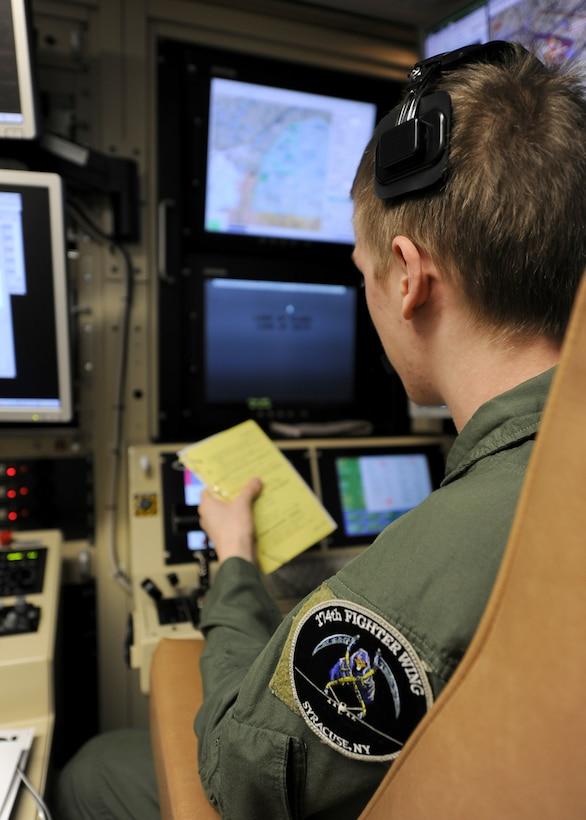 A student sensor operator mans the controls of a MQ-9 Reaper in a ground-based cockpit during a recent training mission flown from Hancock Field Air National Guard Base, Syracuse, New York.  The 174th Fighter Wing is the only Air National Guard unit to operate a MQ-9 Formal Training Unit (FTU) program to train aircrews from the active duty Air Force, Air National Guard and Air Force Reserve. (photo by Tech. Sgt. Ricky Best/Released)