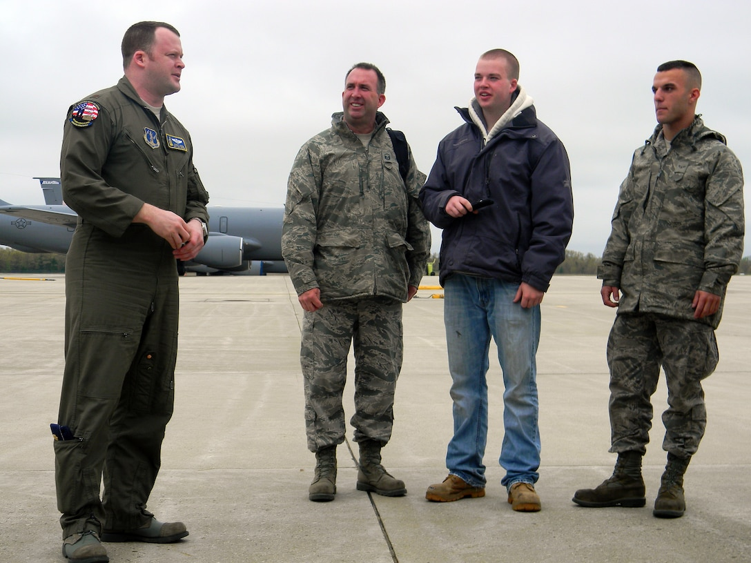 PEASE AIR NATIONAL GUARD BASE, N.H. -- Maj. Corey Aiken briefs Christopher Poulin, Master Sgt Al Poulin and Airman 1st Class Don Boyer prior to boarding a KC-135 orientation here May 5. Five wing members with three of their  family members, experienced the mid-air refueling during the flight. (National Guard photo by Capt. Suzanne Lamb/RELEASED)