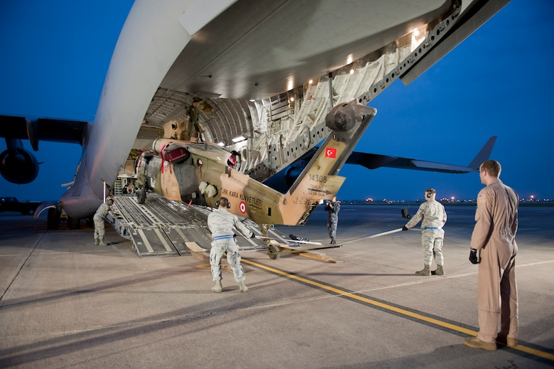 A Turkish air force UH-60 Black Hawk helicopter is loaded onto a U.S. Air Force C-17 Globemaster III May 1, 2012, at Incirlik Air Base, Turkey. A C-17 aircrew from Joint Base McGuire-Dix-Lakehurst, N.J., transported the helicopter to Kabul, Afghanistan, May 5, 2012. The joint support mission provided smooth delivery of the helicopter to replace one that crashed December 2011. (U.S. Air Force photo by Senior Airman Anthony Sanchelli/Released)