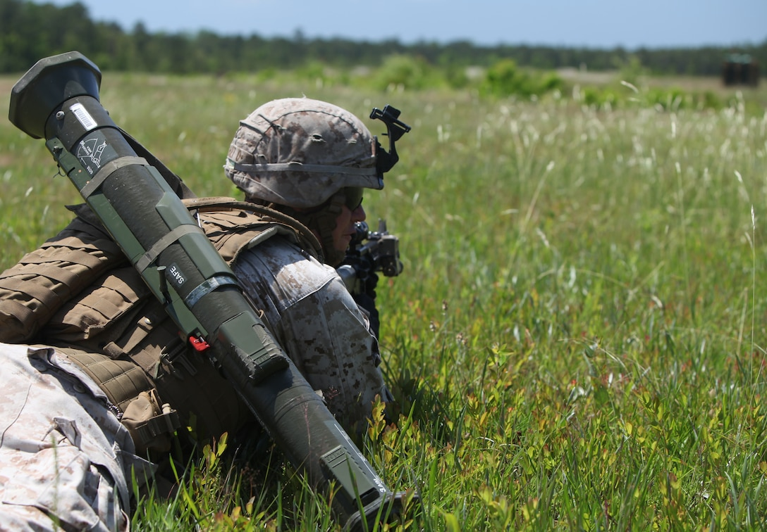 Cape Coral, Fla., native Lance Cpl. Nick A. Sauer, a rifleman with Golf Company, 2nd Battalion, 2nd Marine Regiment, 2nd Marine Division, waits for commands from his fire team leader during a simulated machine gun bunker assault May 10. The simulated assault was part of a two-and-half-week Tactical Small Unit Leadership Course more than 45 potential fire team leaders with the battalion attended. (Official U.S. Marine Corps photo by Cpl. Andrew D. Johnston)