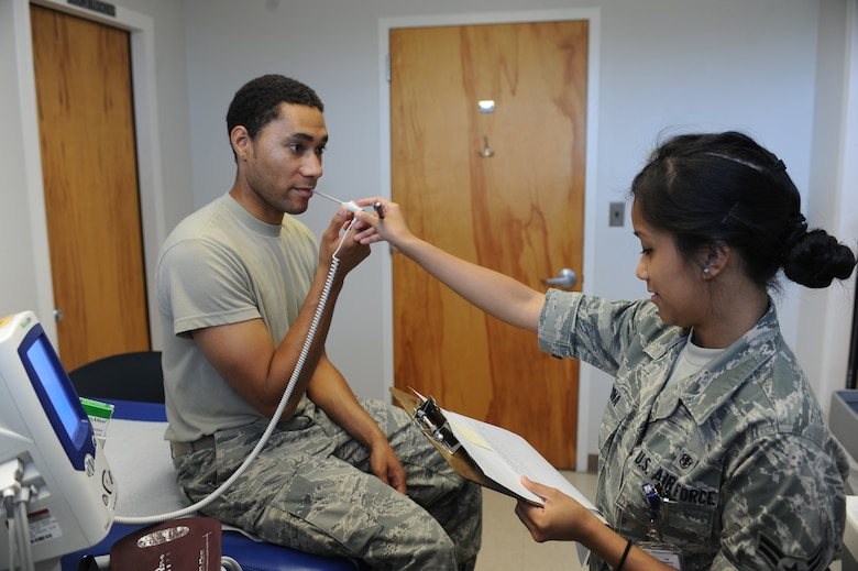 U.S. Air Force Airman 1st Class Janna Harina checks Senior Airman Reginald Graves' temperature with a thermometer probe at the 4th Medical Group on Seymour Johnson Air Force Base, N.C., May 8, 2012. Along with taking patients' temperatures Harina also checks their weight and records their blood pressure. Harina, 4th Medical Operations Squadron medical technician, is from San Diego. Graves, 4th Component Maintenance Squadron test measurement diagnostic equipment technician, is a native of Raleigh, N.C. (U.S. Air Force photo/Airman 1st Class John Nieves Camacho/Released)