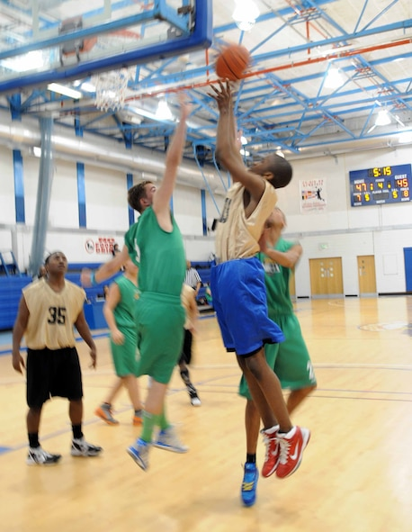 RAF MILDENHALL, England – Jonathan Doss, RAF Mildenhall and RAF Lakenheath combined youth seventh and eighth grade basketball team, makes a layup during a game against a Lynn Nets basketball club's under 16 team May 5, 2012 at the Lakenheath Fitness Center. The Nets won the first game, 55 to 58, and the American youth won the second game, 56 to 55. (U.S. Air Force photo/Senior Airman Rachel Waller)