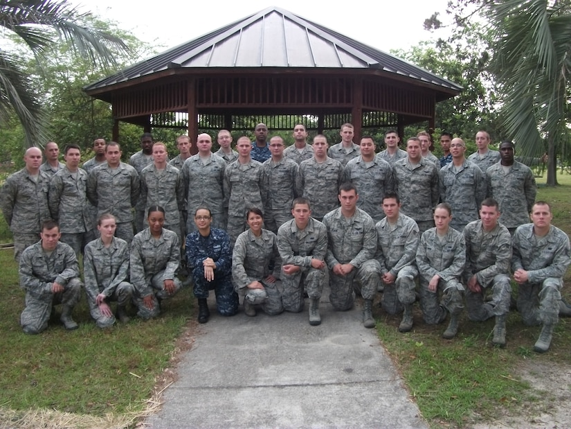 Students from Joint Base Charleston's Airman Leadership School pose for a class photo. Class 12-D was the first class to graduate Navy Sailors from JB Charleston's ALS. The Sailors are (third row center) Petty Officer 2nd Class Japheth Tillman, from the Naval Health Clinic Charleston, (third row right) Petty Officer 2nd Class Bradley Nguyen, from the 628th Security Forces Squadron and Petty Officer 2nd Class Crystal Medina, (first row) from the 628th Communications Squadron. (Courtesy photo)