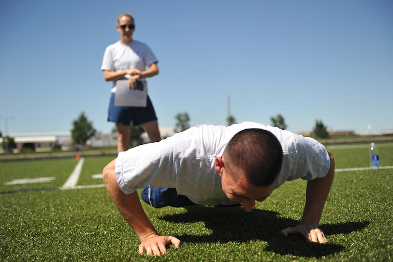 BUCKLEY AIR FORCE BASE, Colo. – Staff Sgt. Lauren Twigg, behind, Buckley AFB First Term Airman Center instructor, leads a group physical training session July 13, 2011. Buckley is playing its part in promoting May as National Fitness Month by having plenty of activities and classes planned throughout the month. (U.S. Air Force photo by Airman 1st Class Phillip Houk)