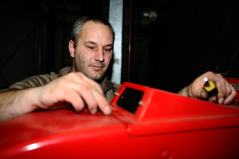 SPANGDAHLEM AIR BASE, Germany – Hubert Berger, 52nd Civil Engineer Squadron Operations Flight Heating, Ventilation and Air Conditioning Element boiler mechanic, reattaches the cover on an oil burner after performing biannual cleaning of a boiler in Bldg. 34 here May 9. HVAC maintains, repairs and installs heating, cooling and ventilation systems located on Bitburg Annex, Spangdahlem AB and all of its geographically separated units. (U.S. Air Force photo by Airman 1st Class Matthew B. Fredericks/Released)