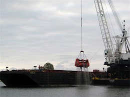 CALIFORNIA — A clamshell dredge begins a five-month project May 2 to remove up to 350,000 cubic yards of material from the federal channel in Newport Harbor, Calif. The Port of Long Beach will use about one-third of the dredged material for its middle harbor redevelopment project.