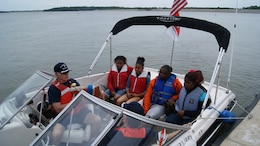 CARLYLE, Ill. — Members of U.S. Coast Guard Auxiliary discuss boating safety with students May 8 before taking them on a ride around Carlyle Lake.