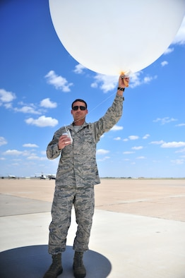 U.S. Air Force Staff Sgt. Phillip Tori, 27th Special Operations Support Squadron weather forecaster, stands on the flightline prepared to launch a weather balloon at Cannon Air Force Base, N.M., May 9, 2012. Troops with the weather flight at Cannon deal largely with resource protection and are able to track any weather systems that directly impact the base or personnel. (U.S. Air Force photo by Airman 1st Class Alexxis Pons Abascal)