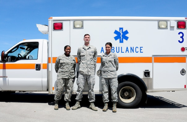 ANDERSEN AIR FORCE BASE, Guam-Emergency response Airmen from the 36th Medical Group stand in front of an ambulance in recognition of the recent ambulatory services upgrades May 7. The new services upgrades include the ability for the Airmen to use new pharmaceuticals in route to the hospital as well as administer electrocardiograms. (U.S Air Force photo by Senior Airman Jeffrey Schultze)