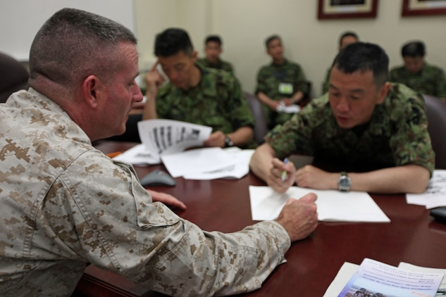 Colonel Andrew R. MacMannis, commanding officer of the 31st Marine Expeditionary Unit, discusses MEU capabilities with a member of the Japanese Self Defense Forces during a meeting in the 31st MEU headquarters, May 14. The JSDF requested a meeting with the MEU, to gain a better familiarity with the unit's expeditionary and amphibious capabilities. The 31st MEU is the only continuously forward deployed MEU, and the United States' force in readiness for the Asia Pacific region.
