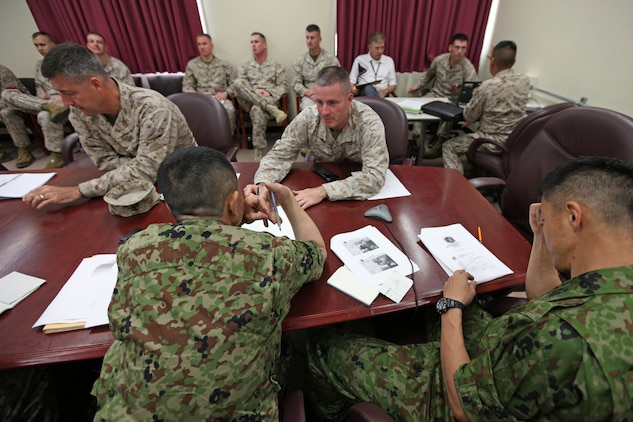 Colonel Christopher P. Coke (Left), assistant chief of staff for operations, III Marine Expeditionary Force, and Col. Andrew R. MacMannis, commanding officer for the 31st Marine Expeditionary Unit, speak with members of the Japanese Self Defense Forces during a meeting in the 31st MEU headquarters, May 14. The JSDF requested a meeting with the MEU, to gain a better familiarity with the unit's expeditionary and amphibious capabilities. The 31st MEU is the only continuously forward deployed MEU, and the United States' force in readiness for the Asia Pacific region.