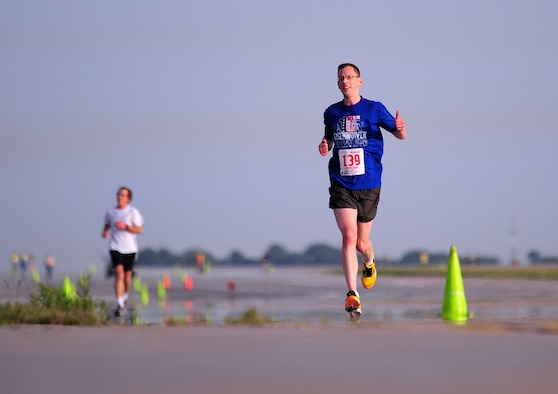 Peter Ward gives thumbs up as he participates in the annual Bellevue-Offutt Runway Run at Offutt Air Force Base, Neb., May 13. Nearly 200 runners participated in this year's race. (U.S. Air Force Photo by Josh Plueger)